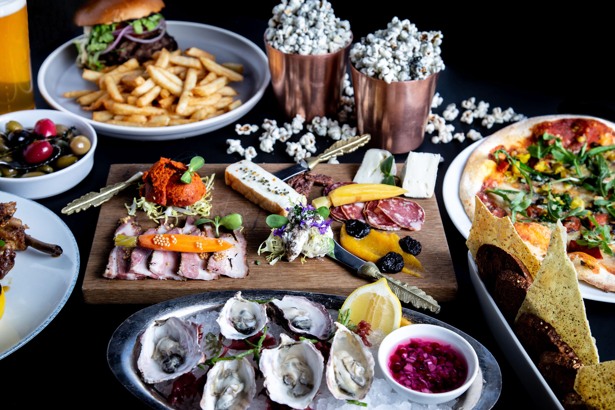 Burger and fries, popcorn, charcuterie, oysters