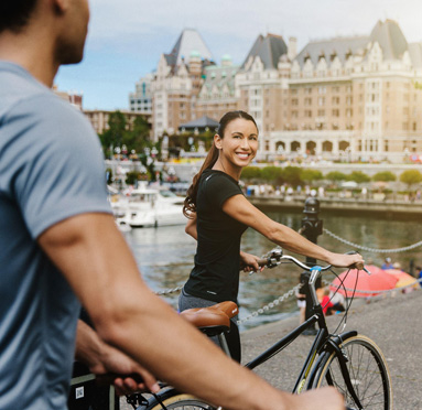 Couple exploring the Inner Harbour on bicycles